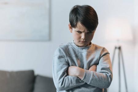 Upset little kid boy at home