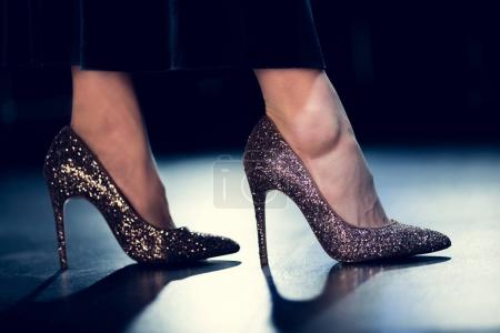 Photo for Cropped view of glamour woman walking in shiny glitter high heels and long dress - Royalty Free Image