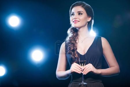 Stylish woman drinking champagne