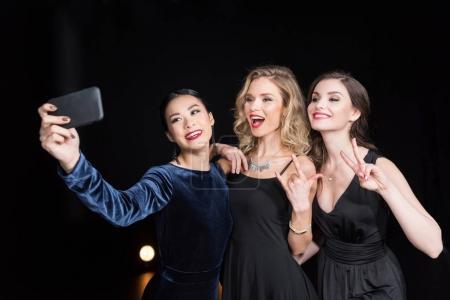 women taking selfie on smartphone