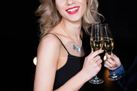 blonde woman holding champagne glass