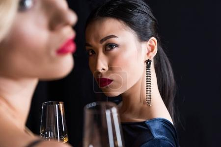 fashionable girls drinking champagne