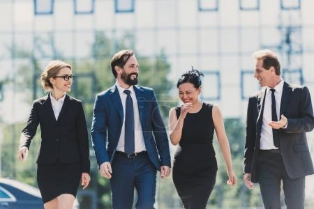 multiethnic businesspeople walking in city