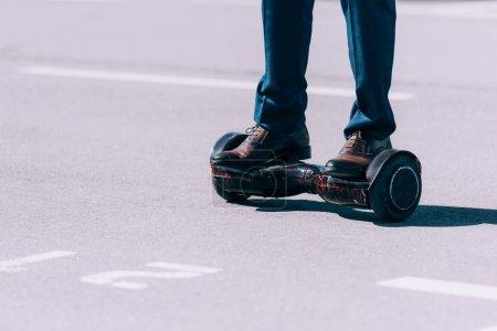Businessman riding gyroboard