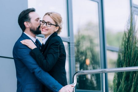 mature business people hugging