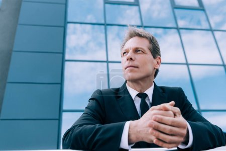 pensive mature businessman