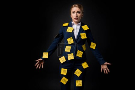 stressed businesswoman with sticky notes
