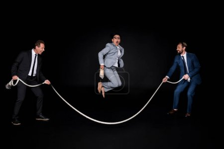 business colleagues having fun with rope