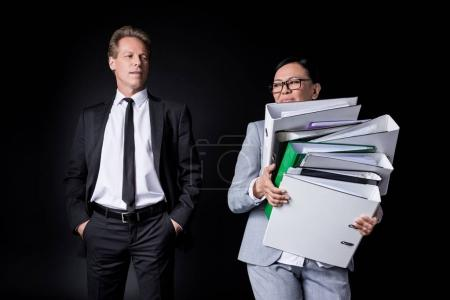 business colleagues with folders
