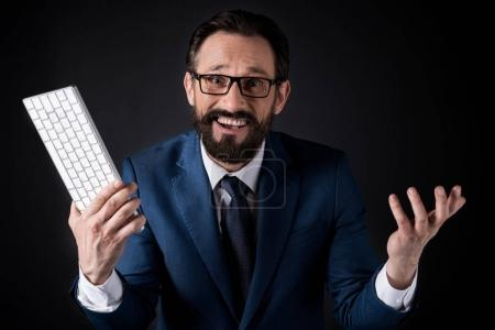 excited businessman with keyboard
