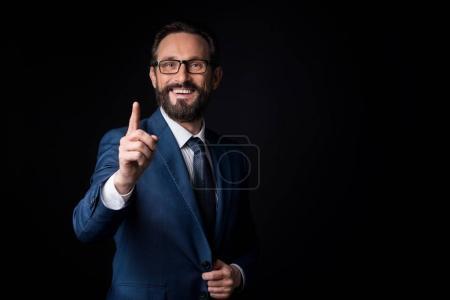 Cheerful businessman having idea
