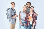 multiethnic teenagers with backpacks