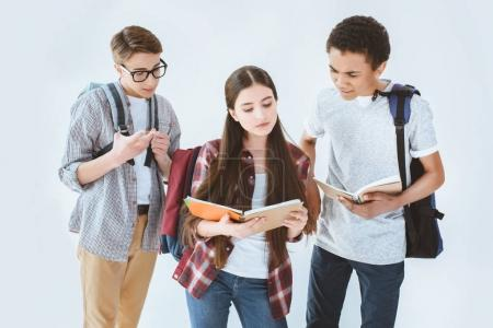 Multiethnic students with backpacks and notebooks