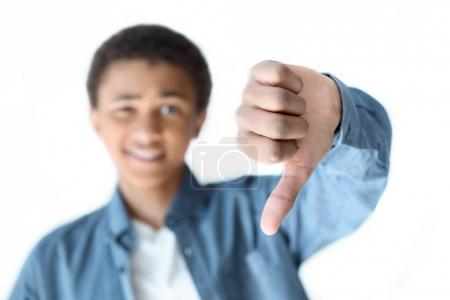 african american teenager showing thumb down