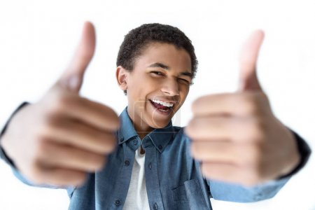 african american teenager showing thumbs up