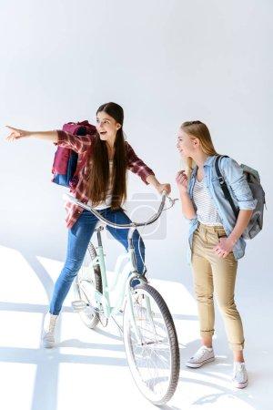 teenage girl pointing away