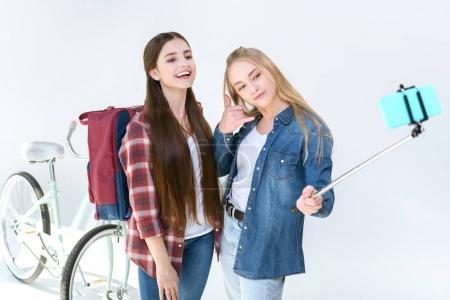 teenage friends taking selfie together