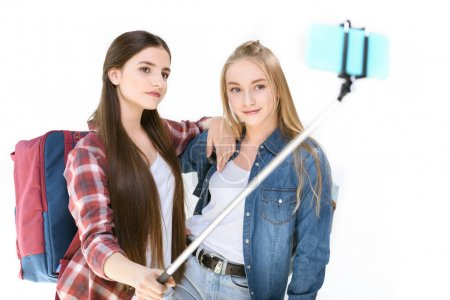 Teenage girls taking selfie together
