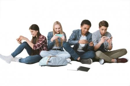 multicultural teenagers using smartphones