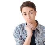 Portrait of upset caucasian teenage boy with hand ...