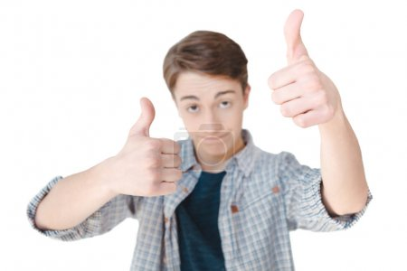 caucasian teenager showing thumbs up