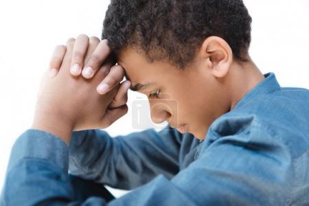 Pensive african american teenage boy