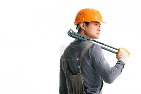 Construction worker with pipe wrench