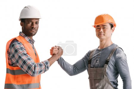 team of african-american and asian construction workers