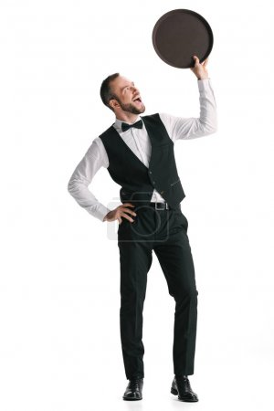 Happy waiter in suit with tray