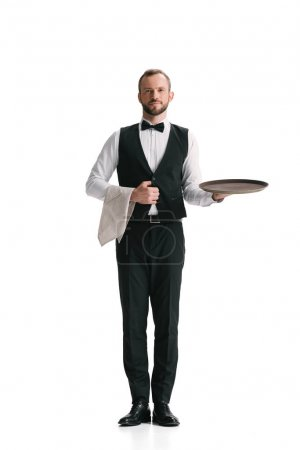 Photo for Handsome smiling waiter in suit with tray isolated on white - Royalty Free Image