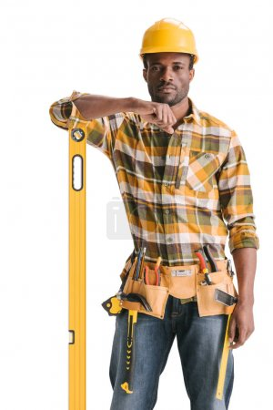 Construction worker with leveling tool