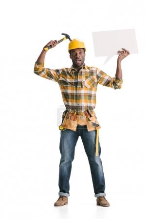 Photo for Builder holding blank speech bubble and hammer isolated on white - Royalty Free Image