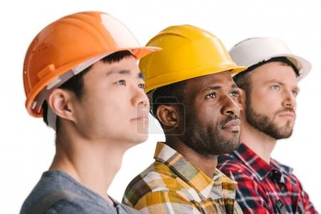 Photo for Side view of group of multiethnic thoughtful construction workers in row - Royalty Free Image