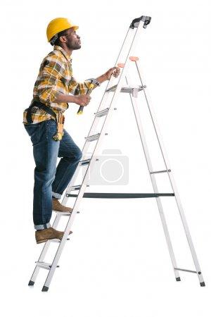 handsome construction worker on ladder
