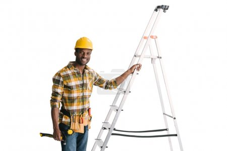 Photo for Handsome smiling construction worker with ladder isolated on white - Royalty Free Image