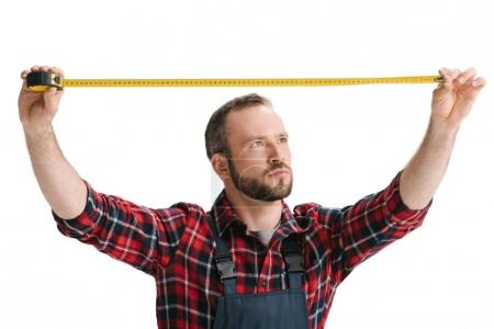 construction worker with measuring tape