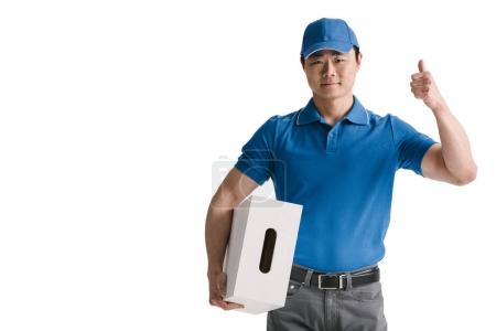 Photo for Handsome young asian courier with blank box isolated on white - Royalty Free Image