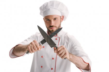 Photo for Handsome young chef sharpening knives isolated on white - Royalty Free Image