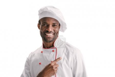 Photo for Handsome african american chef pointing away isolated on white - Royalty Free Image