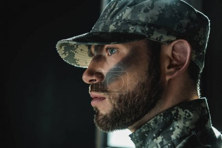 Photo for Close-up portrait of thoughtful young soldier with camouflage on face - Royalty Free Image