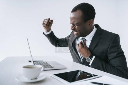 angry african american businessman at workplace