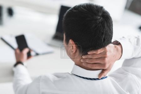 businessman having neck ache