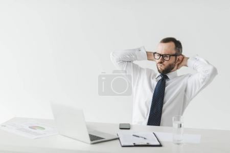 Photo for Portrait of businessman in eyeglasses resting at workspace with documents and laptop - Royalty Free Image