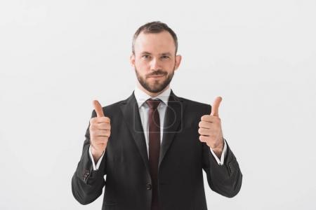 Foto de Retrato de hombre de negocios que muestran los pulgares y mirando a cámara aislada en blanco - Imagen libre de derechos