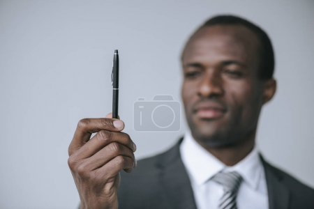 african american businessman with pen