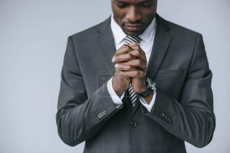 praying african american businessman