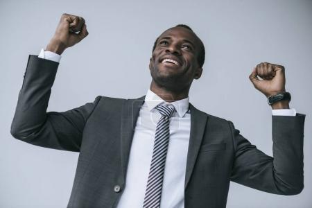 excited african american businessman