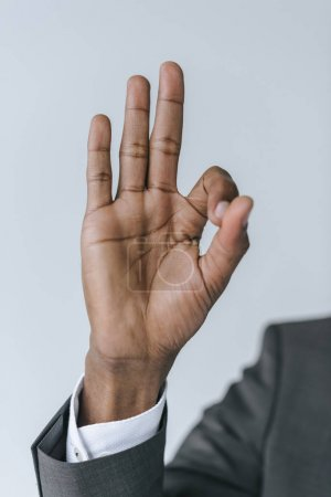 african american businessman showing ok sign