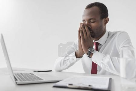 tired african american businessman