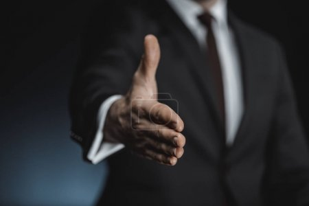 Businessman outstretching hand